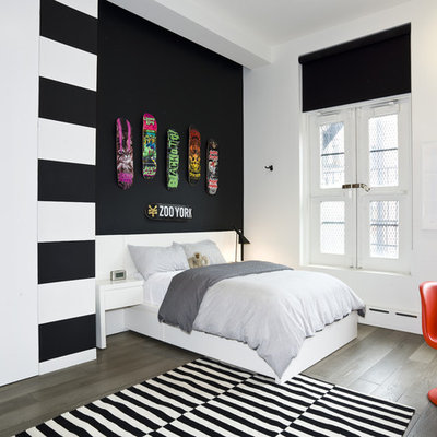 Inspiration for a contemporary dark wood floor bedroom remodel in New York with white walls