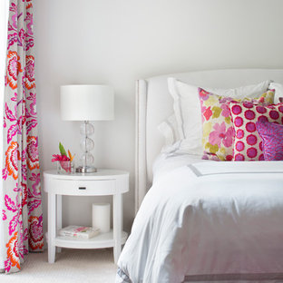 Inspiration for a mid-sized contemporary guest carpeted bedroom remodel in Miami with white walls