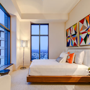 Contemporary bedroom in Los Angeles with beige walls and carpet.