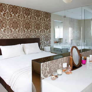 Example of a trendy master bedroom design in London with brown walls