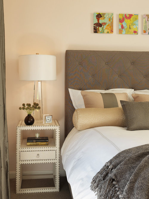Example of a trendy carpeted bedroom design in Boston with beige walls. Art Above Headboard   Houzz