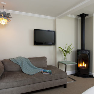 Design ideas for a contemporary bedroom in Boston with a wood stove.