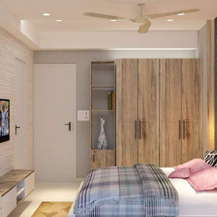 Mid-sized trendy master ceramic tile, white floor, tray ceiling and wallpaper bedroom photo in Kolkata with gray walls