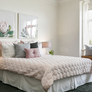 Contemporary bedroom in Hobart with white walls.