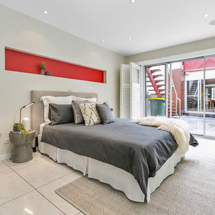 This is an example of a contemporary bedroom in Hobart with beige walls and white floor.