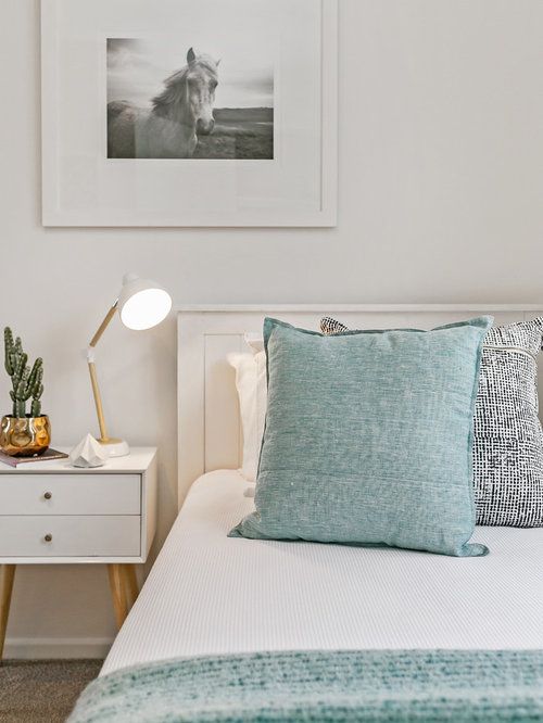 Inspiration For A Contemporary Bedroom In Hobart With White Walls And Beige  Floor.