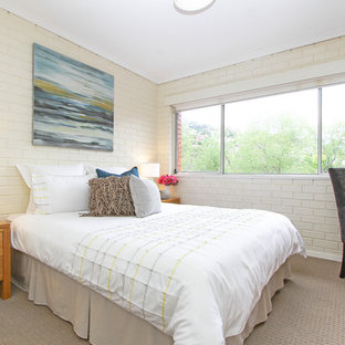 Design ideas for a contemporary bedroom in Hobart with beige walls and carpet.