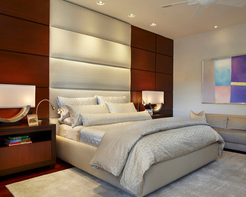 Trendy master dark wood floor bedroom photo in Miami with white walls