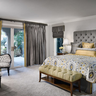 Trendy carpeted and gray floor bedroom photo in San Diego with gray walls and no fireplace