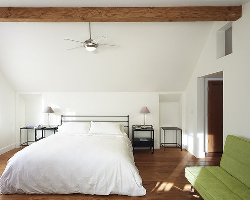 ceiling fans for bedrooms. Example of a trendy medium tone wood floor bedroom design in Other with  white walls Bedroom Fan Houzz