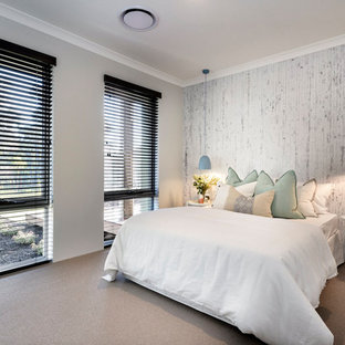 Contemporary guest bedroom in Perth with beige walls, carpet and brown floor.