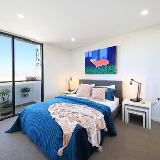 Photo of a mid-sized contemporary bedroom in Sydney with white walls, carpet and grey floor.