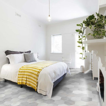Contemporary bedroom with hexagon porcelain tiled floor