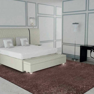 Example of a mid-sized trendy bedroom design in Miami
