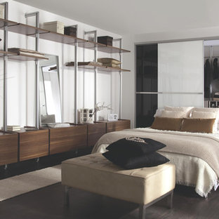 Large trendy master dark wood floor bedroom photo in Hampshire with white walls