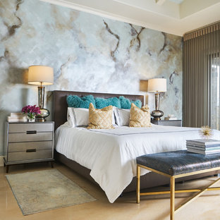 Large transitional master concrete floor and gray floor bedroom photo in Los Angeles with multicolored walls