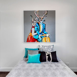 This is an example of a contemporary guest bedroom in Adelaide with white walls, dark hardwood floors and brown floor.