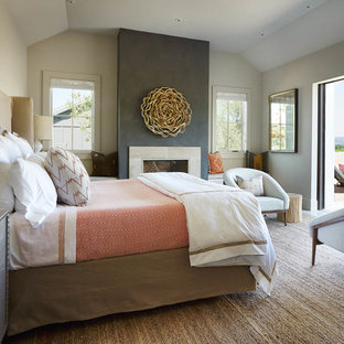 Example of a large transitional master bedroom design in San Francisco with white walls, a standard fireplace and a concrete fireplace