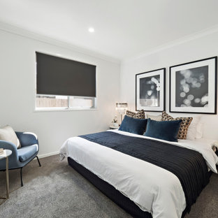 This is an example of a mid-sized contemporary master bedroom in Brisbane with grey walls, carpet and grey floor.