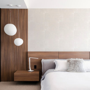 Inspiration for a contemporary bedroom in Brisbane with grey walls and grey floor.