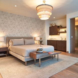 Large trendy guest light wood floor bedroom photo in Denver with white walls
