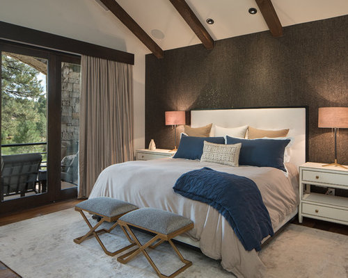 Example Of A Mountain Style Master Dark Wood Floor Bedroom Design In  Phoenix With Gray Walls