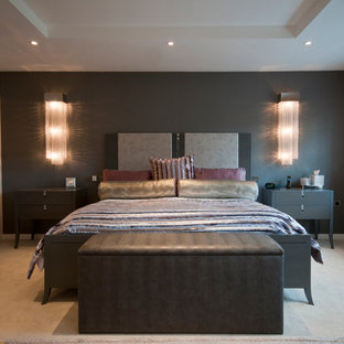 Design ideas for a contemporary bedroom in Manchester with grey walls, carpet, no fireplace and beige floor.