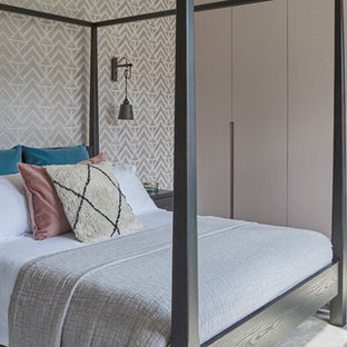 Design ideas for a contemporary master bedroom in Hertfordshire with multi-coloured walls, carpet, no fireplace and grey floors.