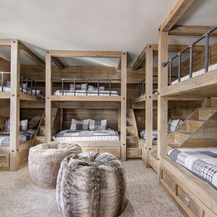 Example of a large mountain style guest carpeted and beige floor bedroom design in Phoenix with beige walls and no fireplace