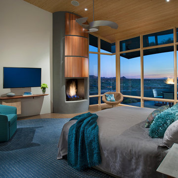 Contemporary teal accented bedroom with contemporary ceiling fan in Carefree, AZ