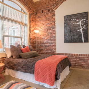 Industrial bedroom in Denver with red walls and concrete flooring.