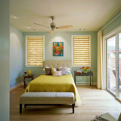 Inspiration for a contemporary light wood floor bedroom remodel in Austin with green walls