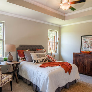 Example of a mid-sized transitional master carpeted and gray floor bedroom design in Oklahoma City with gray walls and no fireplace