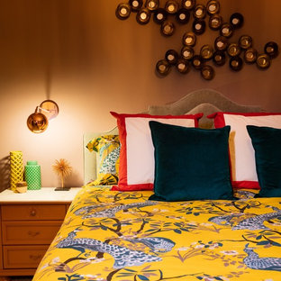 Example of a mid-sized eclectic bedroom design in Orange County