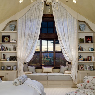 Example of a cottage carpeted bedroom design in Denver with beige walls