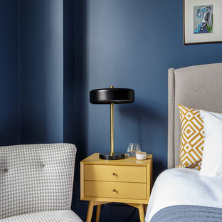 Design ideas for a large modern master bedroom in London with blue walls, carpet and grey floors.