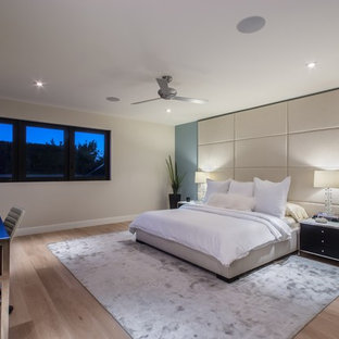 Mid-sized trendy master light wood floor bedroom photo in Orange County with blue walls