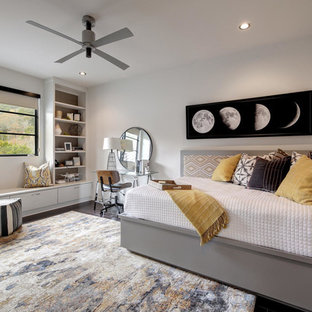 Inspiration for a contemporary dark wood floor and brown floor bedroom remodel in Austin with white walls and no fireplace