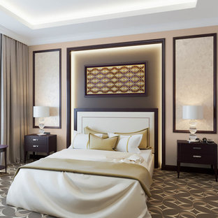 Bedroom - mid-sized modern guest carpeted and brown floor bedroom idea in Other with beige walls, a standard fireplace and a concrete fireplace