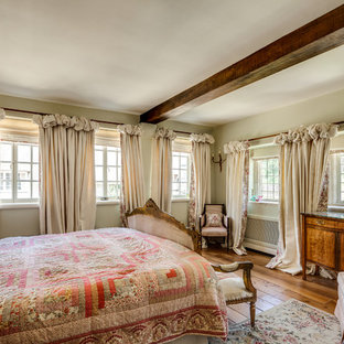 Design ideas for a medium sized victorian bedroom in Gloucestershire with green walls, light hardwood flooring and brown floors.