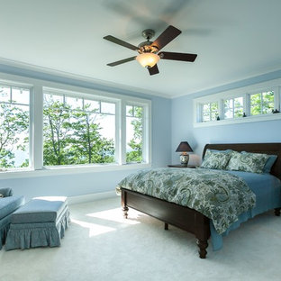 Inspiration for a large arts and crafts master bedroom in Other with blue walls and carpet.