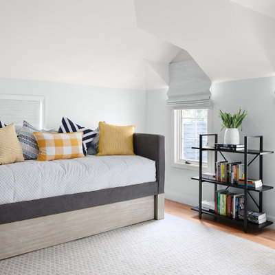 Example of a mid-sized transitional guest medium tone wood floor and brown floor bedroom design in San Francisco with gray walls