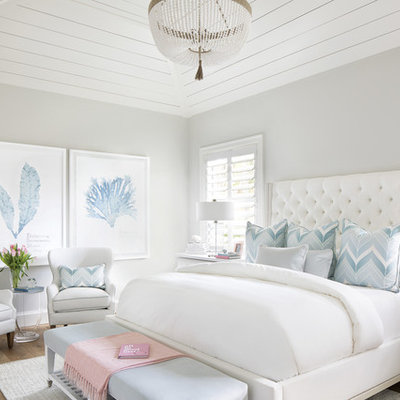 Bedroom - coastal medium tone wood floor and brown floor bedroom idea in Miami with gray walls
