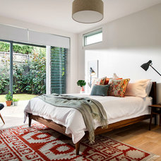 Midcentury Bedroom by Collected Interiors