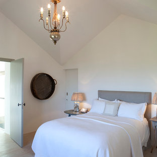 Bedroom - farmhouse light wood floor bedroom idea in London with white walls
