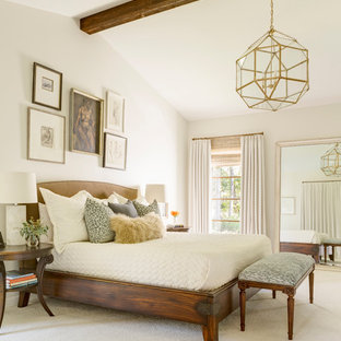 Example of a large farmhouse master carpeted and beige floor bedroom design in Little Rock with white walls