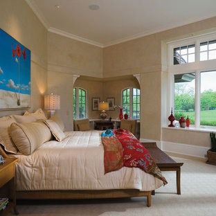 Mountain style carpeted bedroom photo in Minneapolis with beige walls