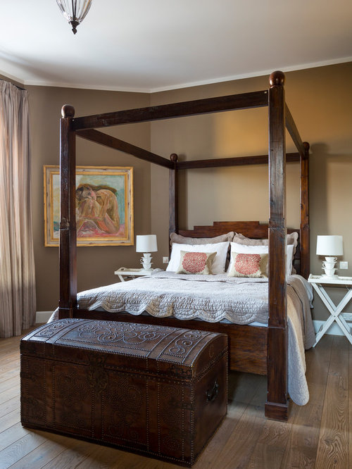 Inspiration for a mediterranean bedroom in London with brown walls, medium  hardwood flooring and brown