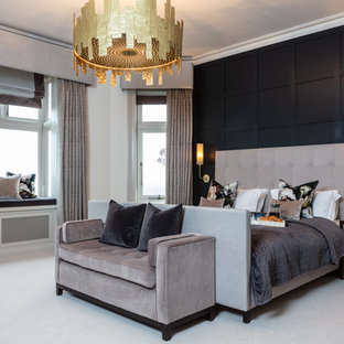 Design ideas for a classic master bedroom in Sussex with black walls, carpet and grey floors.