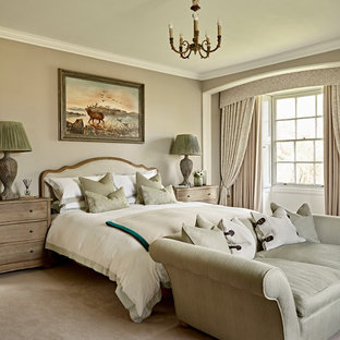 Photo of a medium sized classic bedroom in London with beige walls, carpet and beige floors.